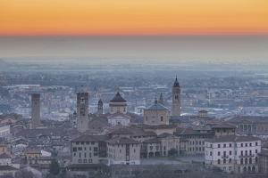 Bergamo, Lombardy, Italy. A view from San Vigilio at dusk. by ClickAlps