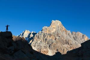 Europe, Italy, Trentino Alto Adige, Cavallazza Piccola. Silhouette of an hiker looking the Cimon de by ClickAlps
