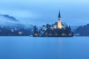 Europe, Slovenia, Upper Carniola. The lake of Bled with the Assumption of Mary Pilgrimage Church by ClickAlps
