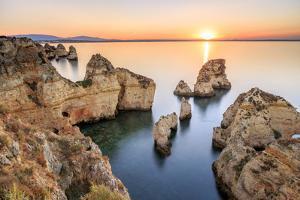 Golden sunrise on the  red cliffs of Ponta da Piedade Lagos Algarve Portugal Europe by ClickAlps