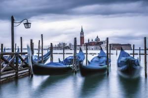 Italy, Veneto, Venice. Gondolas at Dawn with San Giorgio Maggiore Church on the Background. by ClickAlps