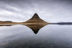 Kirkjufell Mountain reflects itself on the Atlantic waters in Snaefellsnes peninsula, Western Icela by ClickAlps