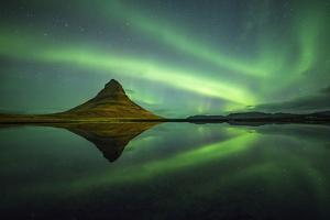Northern lights above Kirkjufell Mountain, Snaefellsnes peninsula, Western Iceland, Europe. by ClickAlps