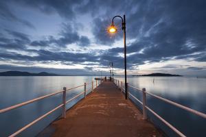 Pier of Lake Trasimeno at Dusk, Perugia, Umbria, Italy. by ClickAlps