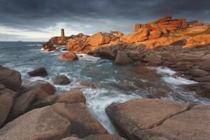 Pink Granite Coast, Brittany, France. the Ploumanach Lighthouse (Men Ruz) an Sunset. by ClickAlps