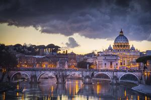 Rome, Lazio, Italy. Sunset on Tevere River, with Saint Peter Cathedral on the Background. by ClickAlps