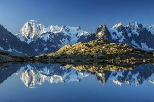 Snowy peaks of Dent Du Geant and Grandes Jorasses are reflected in Lac Blanc, Haute Savoie, France, by ClickAlps