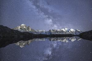 Starry Sky over Mont Blanc Range Seen from Lac De Chesery. Haute Savoie. France Europe by ClickAlps