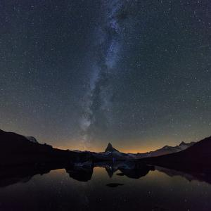 Stars and Milky Way above the Matterhorn reflected in Lake Stellisee Zermatt Canton of Valais Switz by ClickAlps