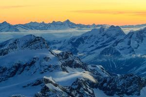 Sunrise view over the Alps from the top of Monte Rosa, Aosta Valley, Italy by ClickAlps
