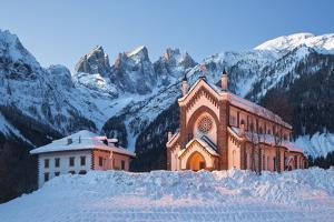 The Church of Falcade, with Focobon Peaks in the Background, in Wintertime, Dolomites, Belluno by ClickAlps