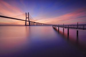 The colors of dawn on  Vasco da Gama Bridge that spans the Tagus River Lisbon Portugal Europe by ClickAlps