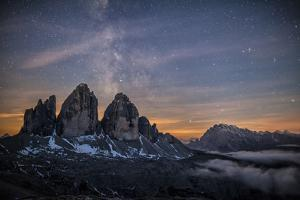 The Milky Way with its Stars Appear in a Summer Night on the Three Peaks of Lavaredo. Dolomites by ClickAlps