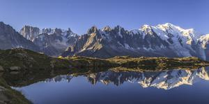 The Mont Blanc Mountain Range Reflected in the Waters of Lac De Chesery at Sunrise by ClickAlps