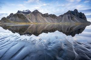 The mountains reflect on the surface of the ocean. Stokksnes, Eastern Iceland, Europe by ClickAlps