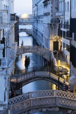 Venice, Veneto, Italy. Bridges over a canal with Bridge of Sights in the background. by ClickAlps