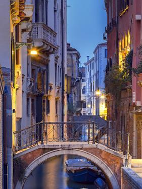 Venice, Veneto, Italy. View over a bridge and a canal at dusk. by ClickAlps