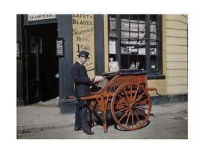 A Postman Delivers Packages with His Parcel Post Barrow by Clifton R. Adams