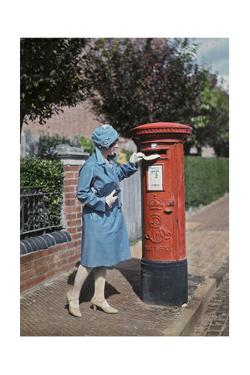 A Young Woman Mails a Letter at the Pillar Box by Clifton R. Adams