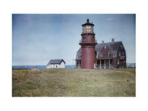 People Relax on the Grounds of the Lighthouse on Martha's Vineyard by Clifton R. Adams