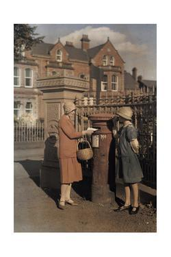 "Two Girls Send a Letter at the Red ""Pillar Box"" of the Royal Mail by Clifton R. Adams"