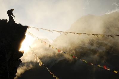 https://imgc.allpostersimages.com/img/posters/climber-on-kala-pattar-peak-5545m-with-buddhist-prayer-flags-at-sunset-nepal-himalaya_u-L-Q10OH0T0.jpg?p=0