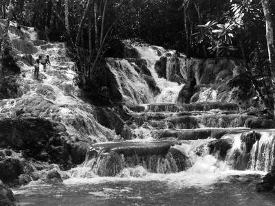https://imgc.allpostersimages.com/img/posters/climbing-dunn-s-river-falls-jamaica-c-1962_u-L-PPQX330.jpg?p=0