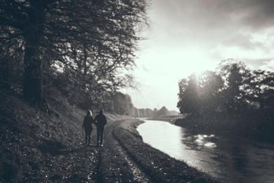 A Couple Walking Along a Canal on a Wet Day