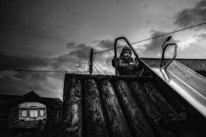 Child on Slide by Clive Nolan