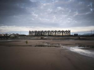 Row of Beach Houses by Clive Nolan
