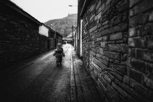Young Child Walking Down Street by Clive Nolan