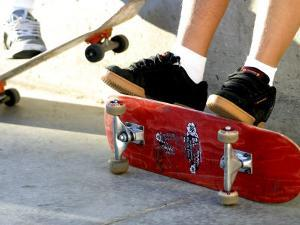 Close-up Image of Feet on Skateboards