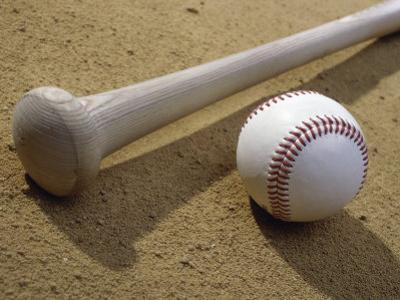 Close-up of a Baseball Bat and a Baseball