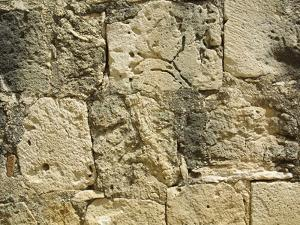 Close-up of a Cracked and Crumbling Stone Wall
