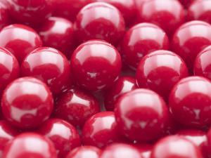 Close-up of a Pile of Red Gumballs