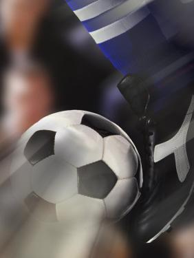 Close-up of a Soccer Player Kicking a Soccer Ball