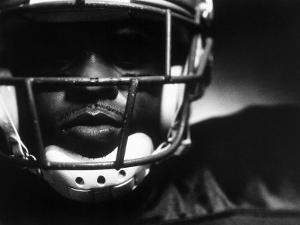 Close-up of An American Football Player Wearing a Helmet