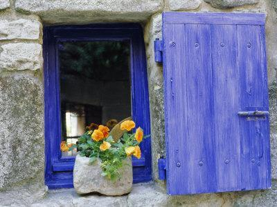 https://imgc.allpostersimages.com/img/posters/close-up-of-blue-shutter-window-and-yellow-pansies-villefranche-sur-mer-provence-france_u-L-P2R3GR0.jpg?p=0