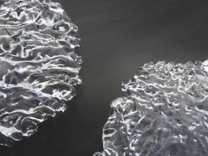 Close-up of Cold Flowing Water with Thin Sheets of Ice
