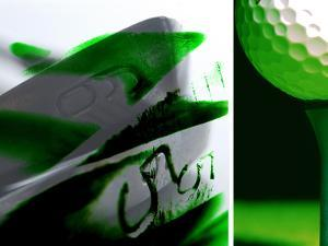 Close-up of Golf Club Irons and Golf Ball on Tee