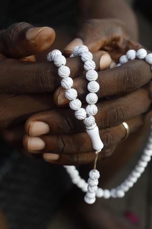 https://imgc.allpostersimages.com/img/posters/close-up-of-hands-of-african-muslim-man-praying-with-islamic-prayer-beads-tasbih-togo_u-L-Q1GYMC40.jpg?artPerspective=n