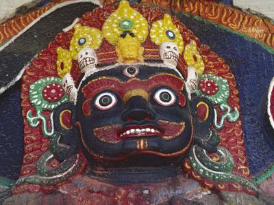 https://imgc.allpostersimages.com/img/posters/close-up-of-statue-of-kalbairab-at-a-hindu-shrine-katmandu-nepal_u-L-P241MQ0.jpg?p=0