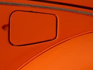 Close-up of the Gas Tank Lid on an Orange Car