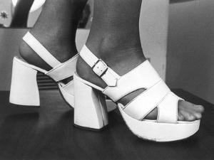 Close-Up Photograph of Feet in a Pair of White Platform Sandals