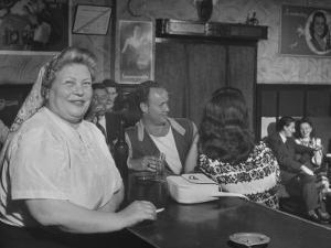 Closeup of a Russian Woman Sitting in the Renaissance Bar Smoking a Cigarette