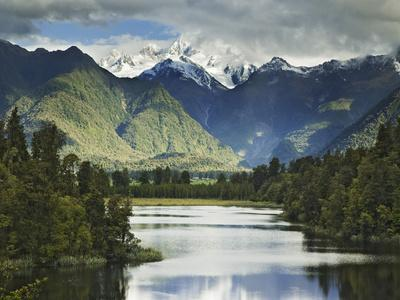 https://imgc.allpostersimages.com/img/posters/cloud-shrouded-mt-cook-reflected-in-lake-matheson-near-town-of-fox-glacier-south-island_u-L-P244GY0.jpg?p=0