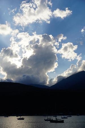 https://imgc.allpostersimages.com/img/posters/clouds-near-nidri-lefkada-lefkas-greek-islands-ionian-sea-greece_u-L-PWFT840.jpg?p=0