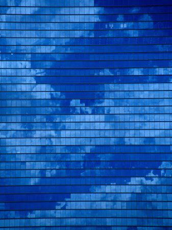 https://imgc.allpostersimages.com/img/posters/clouds-reflected-in-an-office-tower-in-kyobahi-osaka-kinki-japan_u-L-P3SFXP0.jpg?artPerspective=n