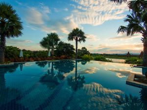 Clouds reflected in the infinity pool at sunrise, Aureum Palace Hotel, Bagan, Mandalay Region, M...