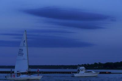 https://imgc.allpostersimages.com/img/posters/cloudscape-at-dusk-with-two-boats_u-L-Q1CQHIN0.jpg?artPerspective=n